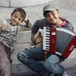 photo - boys playing music in town square, Rhodes, Greece - © Howard Feigenbaum